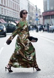Street Style during day 2 of London Fashion Week AW 2017, on Saturday 18th February 2017. Image shows Avishag Nagar from The-Complainers. She wears a hooded dress by Efrat Shenhar Padwa with fur cuffs, sunglasses by Dolce & Gabbana.