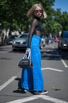 Street Style from day two of London Fashion Week Men's SS 2018 at the Strand, London on 10th June 2017. Image shows model and tattoo artist Pia Kristine Bilaporter from Birmingham, wearing a top by Bones, sunglasses by Ted Baker, a thrift shop bag and Vans skate shoes.