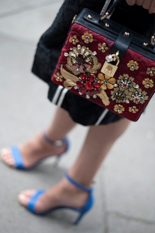 Street Style from day four of London Fashion Week Men's SS 2018 at the Strand, London on Sunday 11th June 2017. Image shows a sall handbag by Dolce & Gabbana