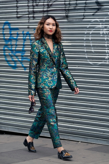 Street Style from day one of Graduate Fashion Week 2017 at the Truman Brewery, London on 4th June 2017. Image shows Thai born Fashion Stylist Peach Chimma from London. She wears a bespoke suit
