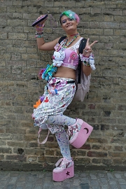 Street style at Hyper Japan 2017, Tobaco Dock, Docklands, London July 15th 2017. Image a young woman dressed in Decora style.