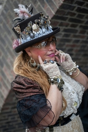 Street style at Hyper Japan 2017, Tobaco Dock, Docklands, London July 15th 2017. Image shows Ann Pendigrast dressed in a SteamPunk inspire stytle, her outfit made by herself.