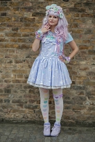 Street style at Hyper Japan 2017, Tobaco Dock, Docklands, London July 16th 2017. image shows a young woman dressed in light Lolita Decora style