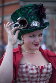 Whitby SteamPunk Weekend July 2017. Image shows a woman dressed in SteamPunk style wearing a corset and a hat.