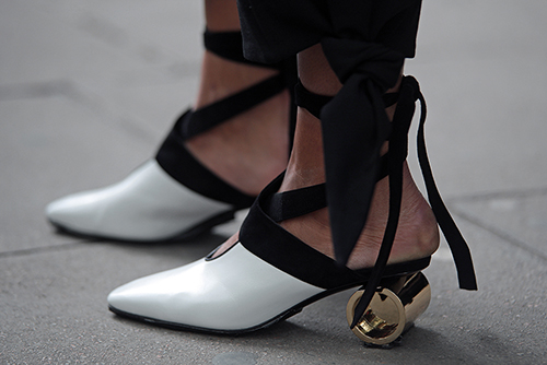 Street Style from Day one of London Fashion Week, Spring Summer 2018, on Friday September 15th 2017. Image shows J.W. Anderson Cylinder Heels.
