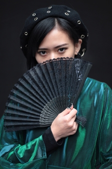 Street Style from Day one of London Fashion Week, Spring Summer 2018, on Friday September 15th 2017. Image shows Freya Sinyu from China, wearing a dress by Bad Taste and a traditional Chinese hand fan.
