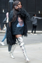 Street Style from Day five of London Fashion Week, Spring Summer 2018, on Tuesday September 19th 2017. Image shows a woman leaving a show wearing silver mirrored thigh high boots.