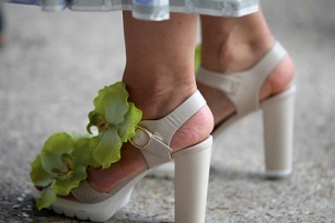 Street Style during Paris Fashion Week Spring Summer 2018 on Saturday 30th September 2017. Image shows a pair of high heel sandals embellished with orchids