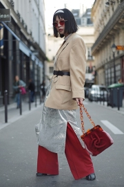 Street Style during Paris Fashion Week Spring Summer 2018 on Saturday 30th September 2017. Image shows Yoii Wang from China. She wears a vintage yellow coat with a silver dress by Indeed Alcohol, shoes by Martin Margiela, a bag by Kun and glasses by Gentle Monster.