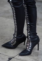 Street Style during Paris Fashion Week Spring Summer 2018 on Sunday 1st October 2017. Image shows a pair of metal eyed lace up black leather boots