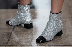 Street Style during Paris Fashion Week Spring Summer 2018 on Sunday 1st October 2017. Image shows a pair of black tip silver glitter and sparkle effect ankle boots by Chanel.