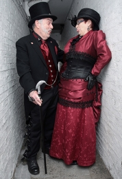 The Whitby Goth Weekend. The biannual Goth culture and fashion gathering is the 2nd largest of its kind in the world, and took place on October 27th - 29th 2017 in the North Yorkshire fishing town. The origins of the Goth festival is said to be based around the town that writer Bram Stoker penned the story of Dracula, drawing inspiration from the abbey looking down upon Whitby. Image shows Festival faves Charlie and Linda Webster, all dressed up in Gothic style, posing for a picture.