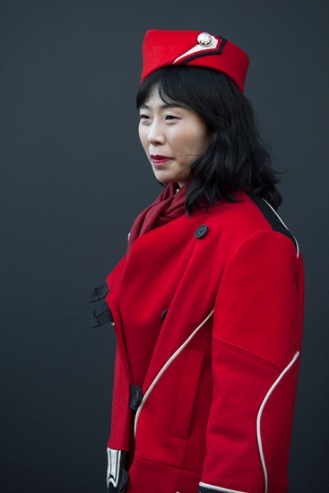 Street Style from day two of London Fashion Week Mens AW 2018. Image shows Japanese journalist Shiho dressed in red.