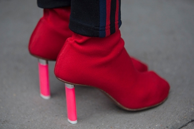 Street Style from day three of London Fashion Week Mens AW 2018. Image shows a pair of sock shoes with lighter heels by Vetements