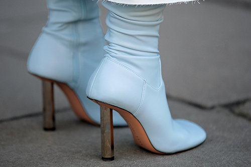 Street Style from day one of London Fashion Week AW 2018. Image shows a pair of leather high heel ankle boots by Vetements
