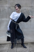 "Street Style from day four of London Fashion Week AW 2018. Image shows fashion buyer and influencer Harper Silin, from China, wearing a T-shirt with slogan ""Love is not complicated. We are tho"". She wears that with a jacket, opera gloves, a bag by GB David, a hand embroidered skirt by And Studio London and boots by Zara."