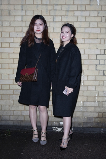 Two stylish Chinese women seen at a special theatrical immersive performance of The Great Gatsby, held in London on Sunday 11th March 2018.