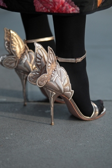 Street Style from day one of London Fashion Week AW 2018. Image shows a pair of high heel sandals with butterfly wings by Sophia Webster.