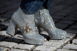 Street Style from day one of London Fashion Week AW 2018. Image shows a pair of high heel shoes with glitter and bug detail, by Gucci, from its SS 2018 collection.