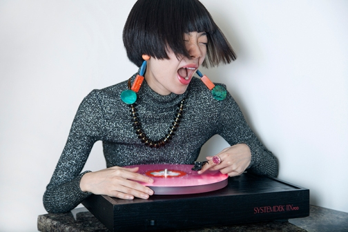 Chinese Fashion influencer Harper Silin celebrates Record Store Day, with some classic coloured vinyl on her record deck.