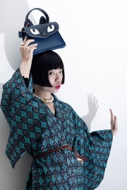 Image shows Chinese Fashion influencer Harper Silin, seen here wearing a vintage Japanese haori with a bag by GB David.