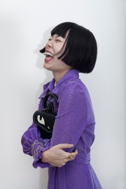 Image shows Chinese Fashion influencer Harper Silin, seen here wearing a vintage purple lurex dress from the 1960s, with a bag by GB David.