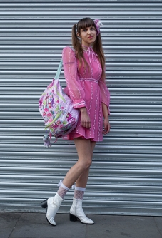 This is Jibby from London. She wears a pink vintage baby doll dress, with ankle boots from TK Max,
