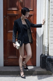 Fashion blogger and Influencer Harper Silin from China at #LFWM June 8th 2108, and Styled by Vintage Fashion Stylist Pat Lyttle. Harper is seen here wearing a black jacket by DSquared2, with a vintage 1950s swimsuit, a bag by GB David, and heels by Aruna Seth.