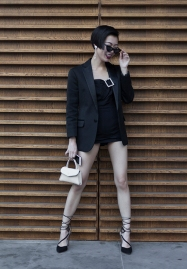 Fashion blogger and Influencer Harper Silin from China at #LFWM June 8th 2108, and Styled by Vintage Fashion Stylist Pat Lyttle. Harper is seen here wearing a black jacket by DSquared2, with a vintage 1950s swimsuit, cats eye sunglasses, a bag by GB David, and heels by Aruna Seth.