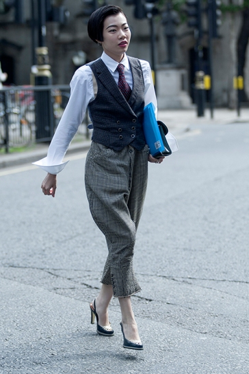 Street style on day two of London Fashion Week Mens, on Saturday June 9th 2018. Image shows fashion blogger and Influencer Harper Silin from China, at #LFWM Styled by Vintage Fashion Stylist Pat Lyttle. Harper is seen wearing a complete vintage menswear look of bespoke Victorian trousers from H. Huntsman & Sons of Savile Row, with braises, a waistcoat by Buckley Tailors, a shirt by Community Clothing, a red tie, a bag by GB David, and vintage heels by Perez Juan.