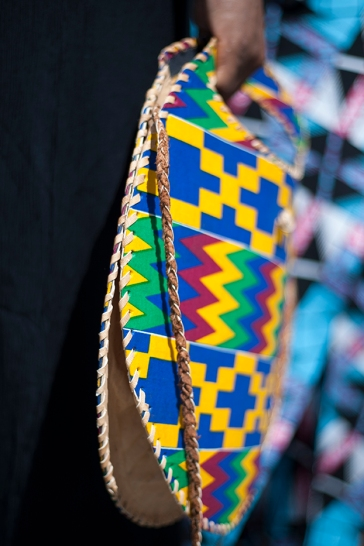 Africa Fashion Week London 2018 at the venue of Freemasons' Hall. IImage shows a vivid multi coloured leather circular shaped bag with geometric patters.
