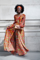 Africa Fashion Week London 2018 at the venue of Freemasons' Hall. Image shows Mary Salim who wears a dress by Lili's Creations and a clutch bag by Hermes