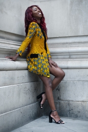 Africa Fashion Week London 2018 at the venue of Freemasons' Hall. Image shows Natalie Desilver from Congo. She wears a printed yellow and blue printed blazer with black velvet trim by Afrodite, with sandals from Boohoo.