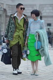 Street Style on the first full day of London Fashion Week SS 2019, on Friday 14th 2018. Image shows Chinese influencer, blogger, PR and fashion buyer Harper Silin arriving at a fashion show. Image shows harper wearing a blue lace vintage dress, with lace kitten heels by Aruna Seth, a bag by GB David, and a green skirt by OSMAN. and her friend Adam from Fashion, a stylist designer and buyer wearing a look of his own creation.