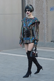 Street Style on the forth full day of London Fashion Week SS 2019, on Monday 17th 2018. Image shows Chinese influencer, blogger, PR and fashion buyer Harper Silin, arriving at a fashion show wearing a vintage couture sequin top, shorts, a statement belt, boots by Zara, and a Chantilly Le Chat Premier bag by GB David, and styled by Pat Lyttle