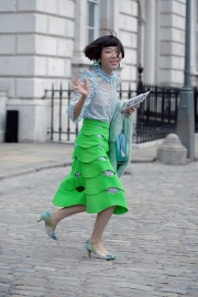 Street Style on the first full day of London Fashion Week SS 2019, on Friday 14th 2018. Image shows Chinese influencer, blogger, PR and fashion buyer Harper Silin arriving at a fashion show. Image shows harper wearing a blue lace vintage dress, with lace kitten heels by Aruna Seth, a bag by GB David, and a green skirt by OSMAN.