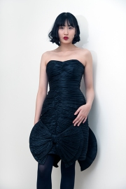Fashion styling by Pat Lyttle. Image shows Film graduate Xaio Giao Wang from China, dressed in a vintage strapless black cocktail dress form the 1980s, with high heels by Pied A Terre.
