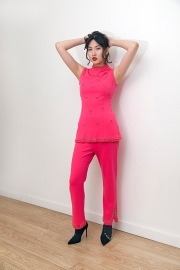 Fashion styling by Pat Lyttle. Image shows Film graduate Xaio Giao Wang from China, dressed in a vintage 1950s pink twin set sleeveless suit, with embellished customised heels by Zara