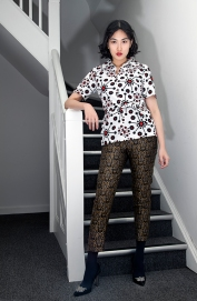 Fashion styling by Pat Lyttle. Image shows Film graduate Xaio Giao Wang from China, dressed in a vintage 1970s top with trousers and high heels by Pied A Terre.