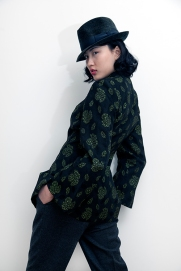 Fashion styling by Pat Lyttle. Image shows Film graduate Xaio Giao Wang from China, dressed in a vintage hat, a 1960s Mandarin collar dress coat and mens trousers.
