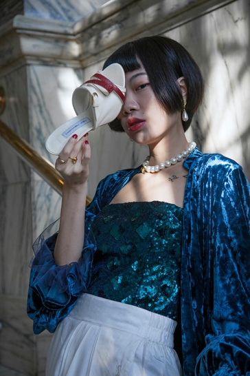 Image shows Chinese fashion buyer, PR, blogger and Influencer Harper Silin with stunning shoes by designer Michael Azu.
