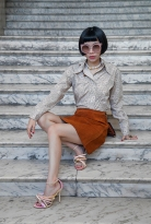 Image shows Chinese fashion buyer, PR, blogger and Influencer Harper Silin. Harper wears a vintage ensemble of a 1970s suede skirt with a silk print blouse, sunglasses by ASociety and the most stunning Orbit shoes by designer Michael Azu, all styled by Pat Lyttle.