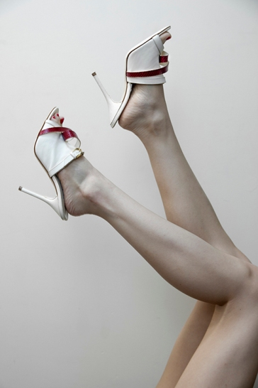 Image shows white mules by shoe designer Michael Azu, all styled by Pat Lyttle.