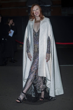 Guests arrive at The Fashion Awards 2018 by the BFC and sponsored Swarovski, and held at the Royal Albert Hall in London on December 10th 2018. Image shows model Karen Elson, wearing a white coat, with a silver silk tulle applique dress under it from Alexander McQueen