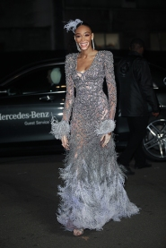 Guests arrive at The Fashion Awards 2018 by the BFC and sponsored Swarovski, and held at the Royal Albert Hall in London on December 10th 2018. Image shows model Winnie Harlow, in a feather detail dress by Versace.