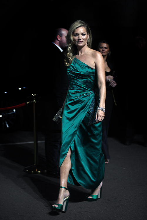 Guests arrive at The Fashion Awards 2018 by the BFC and sponsored Swarovski, and held at the Royal Albert Hall in London on December 10th 2018. Image shows original super model Kate Moss, in a vintage green dress with heels by Jimmy Choo