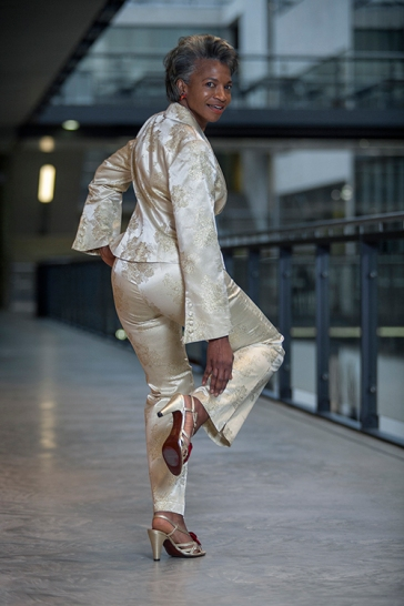 Maureen Salmon founder director of Freshwaters Consultancy, is also senior lecturer and researcher at the University of the Arts London. In this image Maureen wears a gold brocade vintage trouser suit by designer Adebayo Jones Luxury Couture, London, 2002, a clutch bag, with high heel shoes by Chie Mihara. Her hair is styled by Radiant Salon.