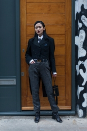 Street Style images from day one of London Fashion Week Men's AW 2019, at the Old Truman Brewery, near Brick Lane. Image shows Freya SinyuSiu SStyled by Pat Lyttle, wearing a men's tuxedo tailcoat by Saint Durant Airey from around 1910-1920s, a men's shirt from Cezari with a silk tie & vintage cufflinks, vintage silver brocade trousers from Kate Moss for Topshop, ankle boots by Gucci with a cylindrical statement bag by YSL.