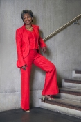 Maureen Salmon founder director of Freshwaters Consultancy, is also senior lecturer and researcher at the University of the Arts London. In this image Maureen wears a red vintage trouser suit, by designer Henrietta Franklyn, London 2002, with high heel shoes by Chie Mihara. Her hair is styled by Radiant Salon.