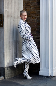 Street Style during day one of London Fashion Week AW 2019. Image shows model Emily O'donell from Milan. She wears a monochrome suit and matching boots by Agne Kuzmickaite